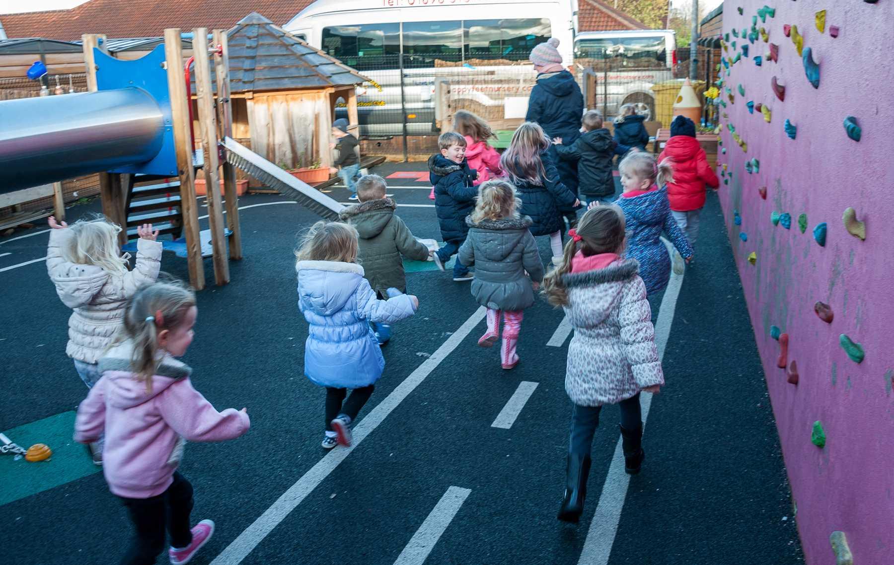 Active Play Area at Happy Feet Nursery - children running